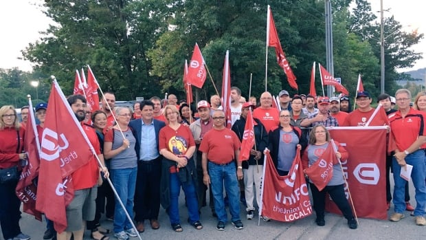Unifor members are gathered inside and outside the Milton, Ont., Northstar Aerospace plant, which is scheduled to close within two months, in a dispute over pensions.
