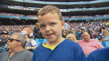 Cancer survivor Harrison Maye at Blue Jays games