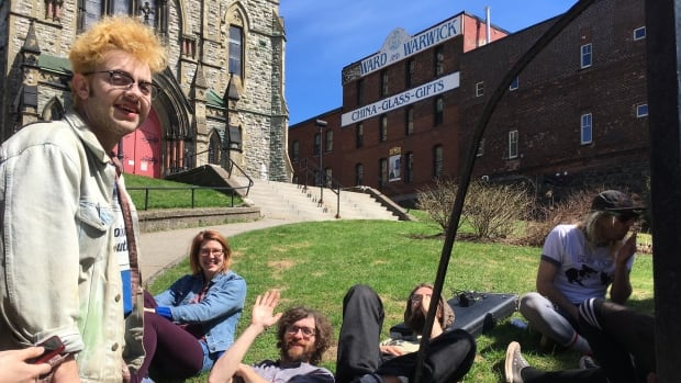 Young folks hang out beside Taco Pica, an all-ages venue, during April's instalment of Saint John indie music festival Quality Block Party.