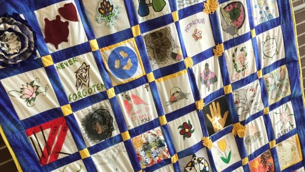 A quilt previously made in honour of missing and murdered Indigenous women hangs on the wall at the Ontario Native Women's Association in Thunder Bay.