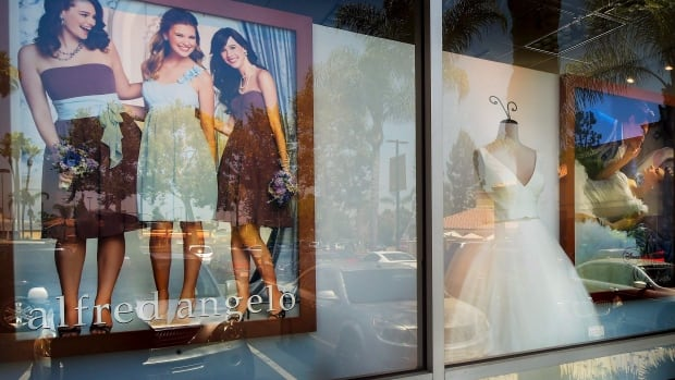 A window display is seen at Alfredo Angelo bridal store in West Covina, Calif. Florida-based bridal retailer Alfred Angelo shuttered its 60 U.S. stores and filed for Chapter 7 bankruptcy liquidation in July, leaving brides-to-be around the world without the gowns they had already ordered.