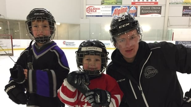 Johnny Foley taught his billet-brothers, Sidney (left) and Cooper, some of his tricks on the ice during his time with the family.
