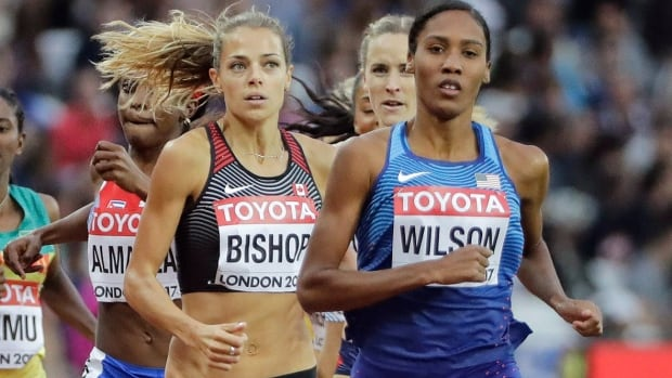 Canada's Melissa Bishop and Ajee Wilson of the United States battle for position in their 800-metre semifinal on Friday at the track and field world championships in London. Bishop, who won a silver medal at the 2015 worlds in Beijing, advanced to Sunday's final with a time of one minute 59.56 seconds.