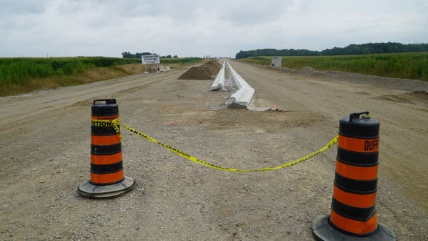 "This is where the extended Veterans Memorial Parkway will connect with Wilton Grove Road south of Highway 401. The extension is expected to open up the area to expansion. A local dairy farmer calls it an unnecessary ""highway to nowhere."""