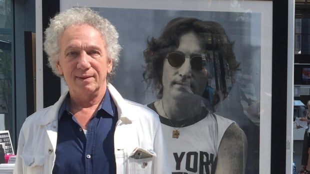 Bob Gruen stands in front of his famous photo of John Lennon at the Pendulum Gallery in Vancouver.