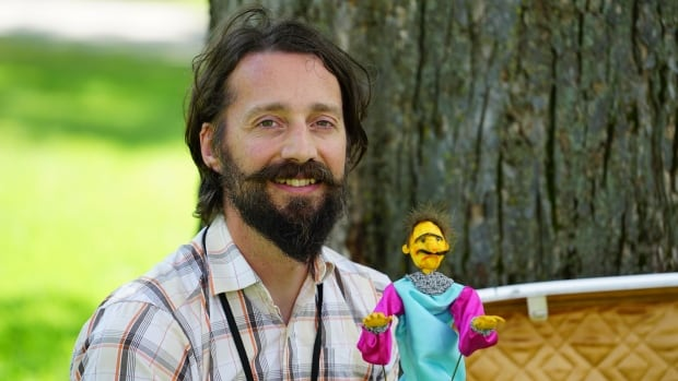 Winnipeg puppeteer Curtis Wiebe is the curator of the Winnipeg Puppet Slam. Here, he's seen with one of his puppets, Synthmaster Allan.