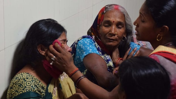 Relatives mourn the death of a child at Baba Raghav Das Hospital in Gorakhpur, in the northern Indian state of Uttar Pradesh, on Friday.