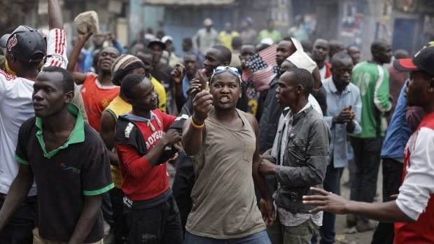 A protester holds up the spent casing of a police round, during a lull in clashes between police and protesters in the Mathare area of Nairobi on Saturday.