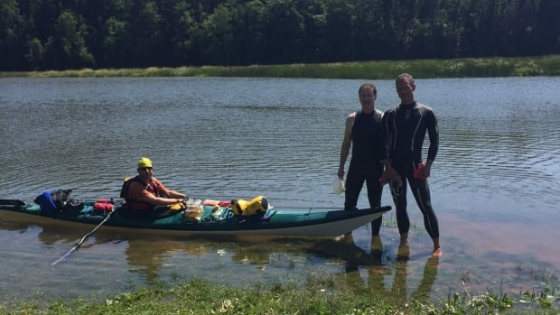 Shannon Burt (left) took a kayak along the route with Ryan Bradley (centre) swimming to make good on his promise to donors to swim the Northumberland Strait in the Big Swim, which was cancelled. Arend teRaa (right), also joined Bradley in the swim.