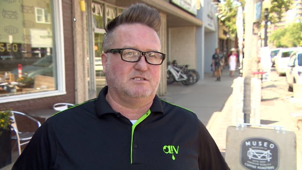 Tim Bannan, the general manager of Oliv Tasting Room on Broadway Avenue, says the parking patios that have popped up on the street this year are costing him business.