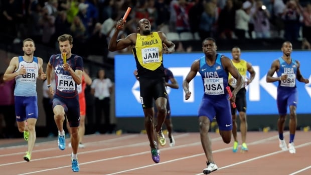 Jamaica's Usain Bolt, centre, pulls up injured in the final of the men's 4x100m relay during the World Athletics Championships in London Saturday, Aug. 12. At right is United States' Christian Coleman.