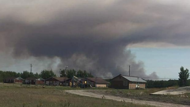 Nearly 300 people have been evacuated from Poplar River First Nation, about 345 kilometres north of Winnipeg, because of smoke from nearby wildfires.