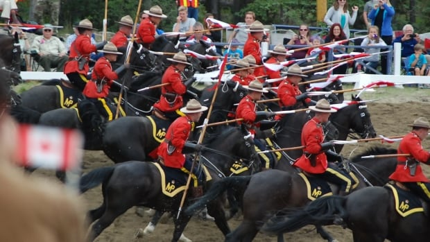 Charge! Officers dip their lances as 32 the black Hanoverian horses rush forward.