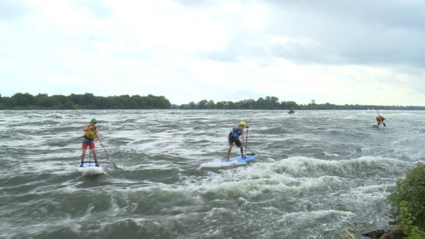 Stand-up paddleboarders competed in the chicken race Saturday afternoon.