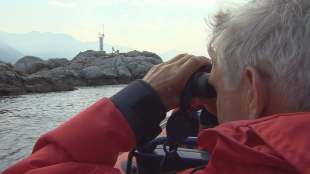 A participant in Bioblitz Canada 150 looks for seals in Howe Sound.