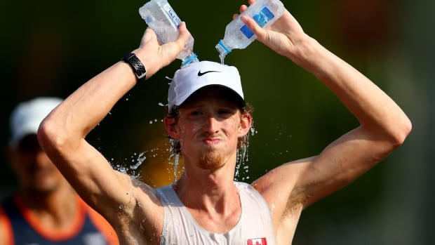 Canada's Evan Dunfee, shown in this 2015 file photo, finished 15th in the men's 50km race walk on Sunday in London, England.