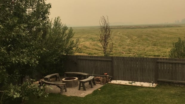 Smoke hovers in High Prairie on Sunday. Environment Canada has issued a special air quality statement.