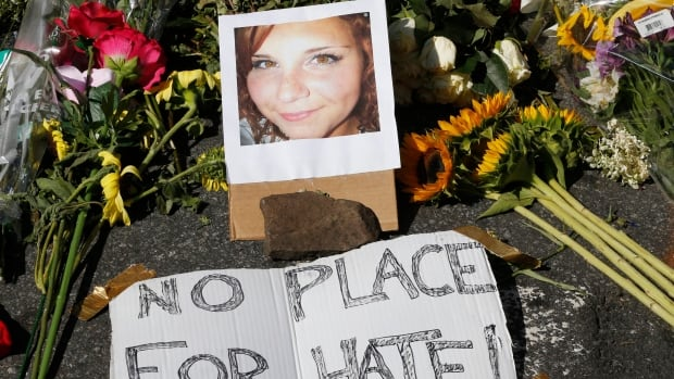 A makeshift memorial for Heather Heyer grew throughout the day Sunday. The 32-year-old's death punctuated an ugly scene in Charlottesville, Va.