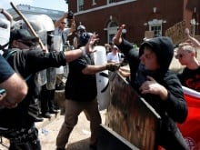 White nationalists, neo-Nazis and members of the 'alt-right' at the 'Unite the Right' rally, Aug. 12, 2017, in Charlottesville, Va. Former white supremacist Tony McAleer says this violent protest should be a wake up call to the U.S. and Canada.