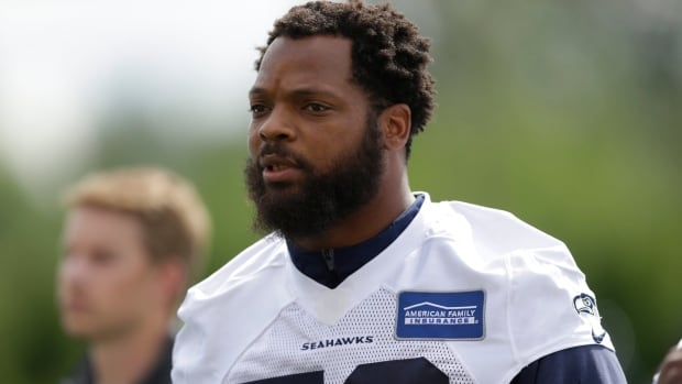 Seattle Seahawks defensive end Michael Bennett says he will sit during the national anthem this season to protest social injustice and segregation.