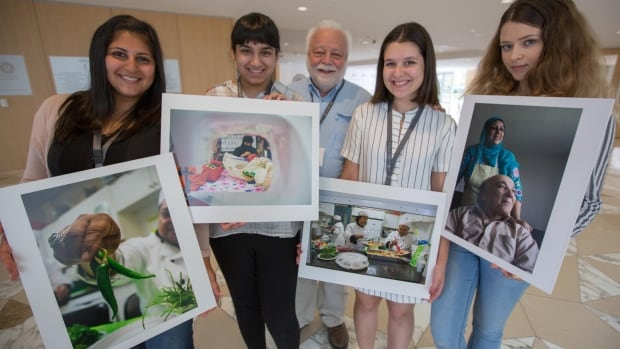Fredric 'Fred' Roberts, centre, taught 20 immigrant and refugee teens in Toronto who had never used a DSLR camera before, how to capture significant moments in their communities.