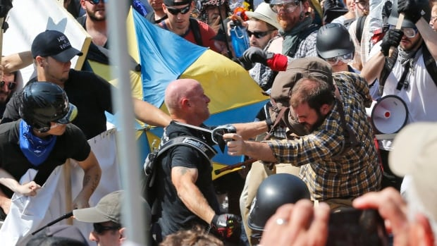 White nationalist demonstrators clash with counter demonstrators at the entrance to Lee Park in Charlottesville, Va., on Aug. 12.