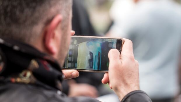 Although bystanders are equipped with technology to film public incidents, a social media expert says there should be more consideration about when it is appropriate to do so.