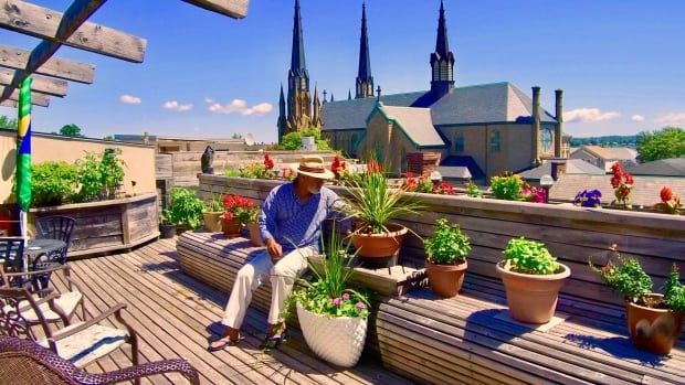 Mamdouh Elgharib has a magnificent view of St. Dunstan's Basilica from his rooftop veggie garden.