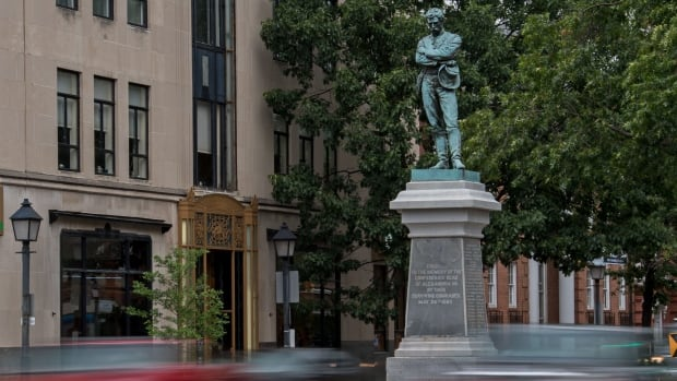 A bronze statue, titled the Confederate Soldier, is seen in downtown Alexandria, Va., on Monday. Across the U.S., 718 Confederate monuments and statues remain, with nearly 300 of them in Georgia, Virginia or North Carolina, according to the Southern Poverty Law Center.