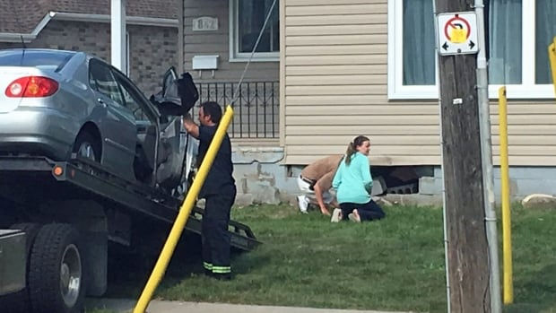 One person was sent to hospital Tuesday after a vehicle slammed into a home in Tecumseh.