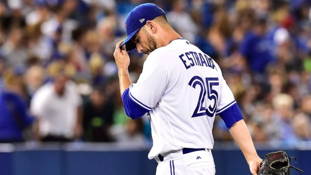 Toronto Blue Jays starting pitcher Marco Estrada walks back to the dugout after being taken out of the game during fifth inning of Tuesday's 6-4 loss to the Tampa Bay Rays.