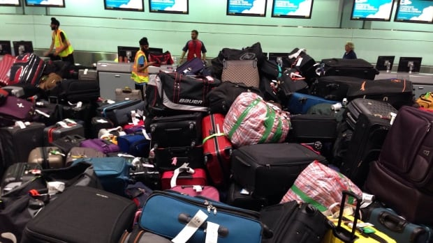 Baggage piled up at Pearson International Airport's Terminal 3 Tuesday night after glitch in the baggage induction system.