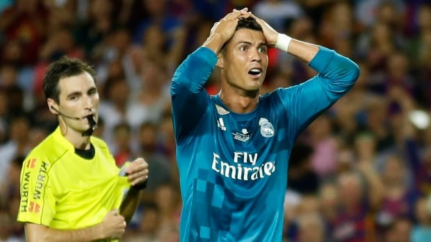 Real Madrid's Cristiano Ronaldo, right, reacts after referee Ricardo de Burgos shows a second yellow card during the Spanish Super Cup.