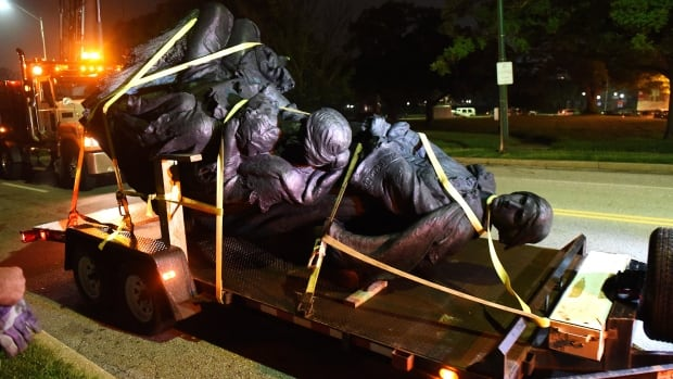 The Confederate Women's Monument sits on a flat bed truck after it was removed overnight by city workers in Baltimore, Md.