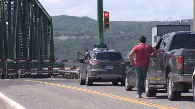 The Canso Causeway saw more than 2,000 boat passages last year. Road traffic is stopped for every one.