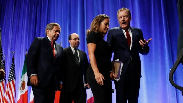 U.S. Trade Representative Robert Lighthizer, right, and Canadian Foreign Affairs Minister Chrystia Freeland leave the stage together after a press conference to open NAFTA renegotiations in Washington Wednesday.