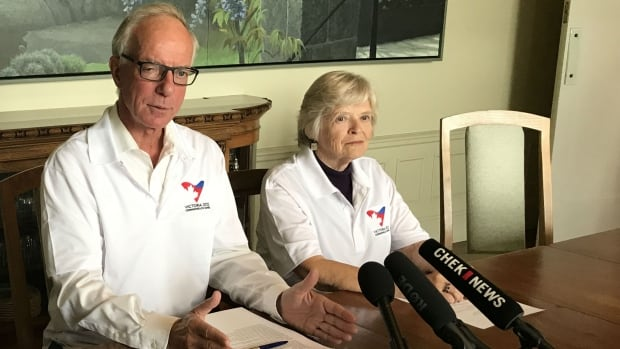 Victoria businessman David Black and Lois Smith, the director of sport administration for the 1994 Commonwealth Games, announce the budget for the 2022 bid.