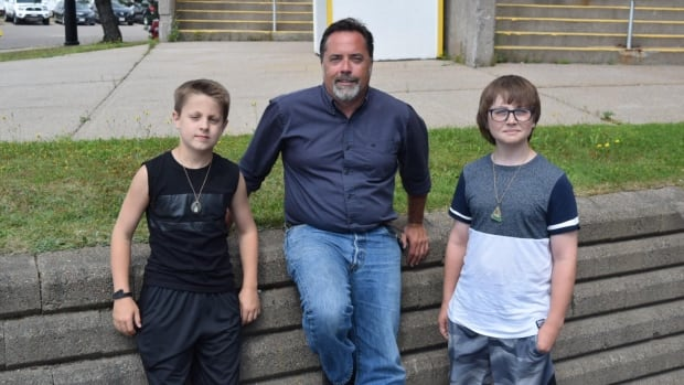 Ben Grant, left, and his brother Sam, right, wanted to meet and say thank you to the man who helped share their story of their guitars being stolen on social media: Warren Beatteay, middle. Beatteay's post was shared nearly 1,000 times in 36 hours.