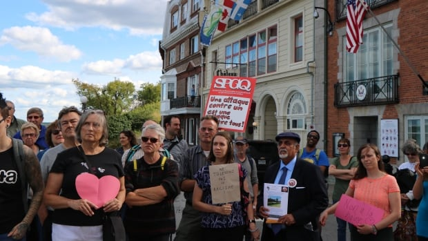 Several dozens gathered in front of the U.S. Consulate General in Quebec City for a rally against racism, following white supremacist demonstrations in Charlottesville, Virginia, which turned violent last week.