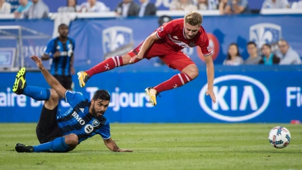 Chicago Fire midfielder Djordje Mihailovic trips over Montreal Impact defender Victor Cabrera during the Impact's win in Montreal on Wednesday.