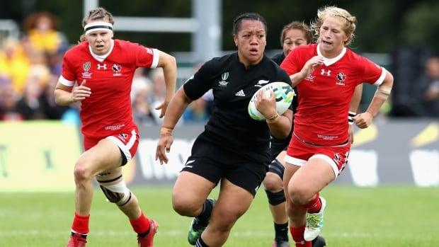 New Zealand's Toka Natua is tackled by Lori Josephson of Canada during a women's rugby World Cup preliminary match.