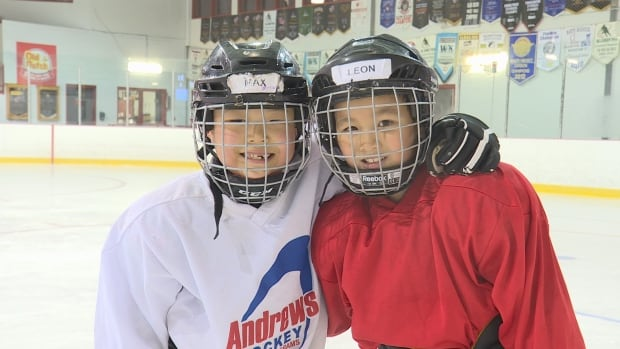Eight-year-olds Max Yin Du (left) and Leon Ling are just two of several students at Kinetic Intelligent Inc. skating school that's looking to teach Chinese newcomers how to skate and play hockey.