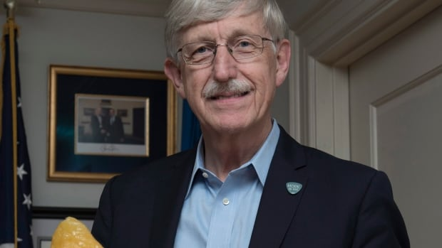 U.S. National Institutes of Health (NIH) Director Francis Collins poses with a fat tissue model. After DNA testing showed he was predisposed to Type 2 diabetes, which is more likely to develop if a person is overweight or obese, Collins shed 35 pounds.