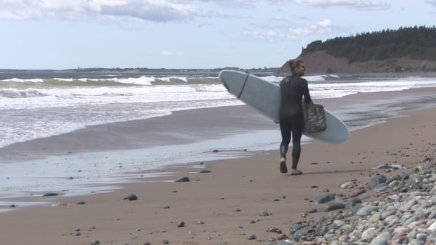 A surfer was taking advantage of the big waves Thursday at Lawrencetown Beach as Hurricane Gert passed southeast of Nova Scotia.