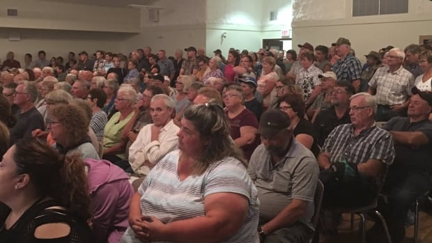 An image tweeted out by Manitoba Liberal MLA Dr. Jon Gerrard shows a packed hall at a meeting in Grandview, Man., this summer about the planned closure of the town's ambulance garage.