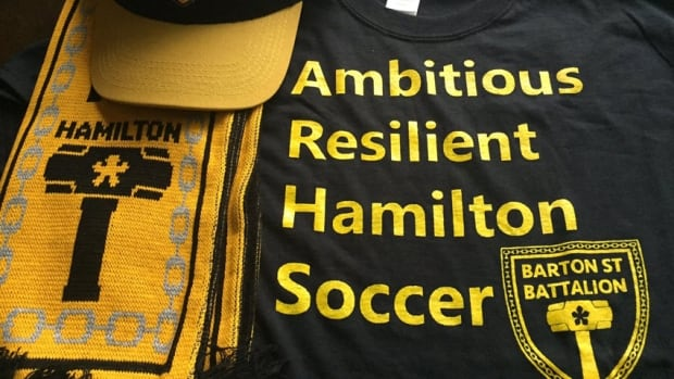 The Barton Street Battalion has shirts encouraging professional soccer in Hamilton. President James Hutton says the group is anxiously watching what happens between the Ticats and the city.