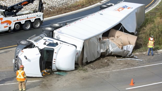 One person was trapped inside a tractor trailer after a the rig rolled over coming onto Highway 401 from Highway 3 late Thursday afternoon.