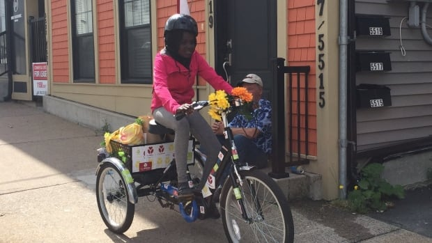 Hope Blooms junior leader Aicha Wade, 12, delivers organic greens and salad dressings to businesses in north-end Halifax.