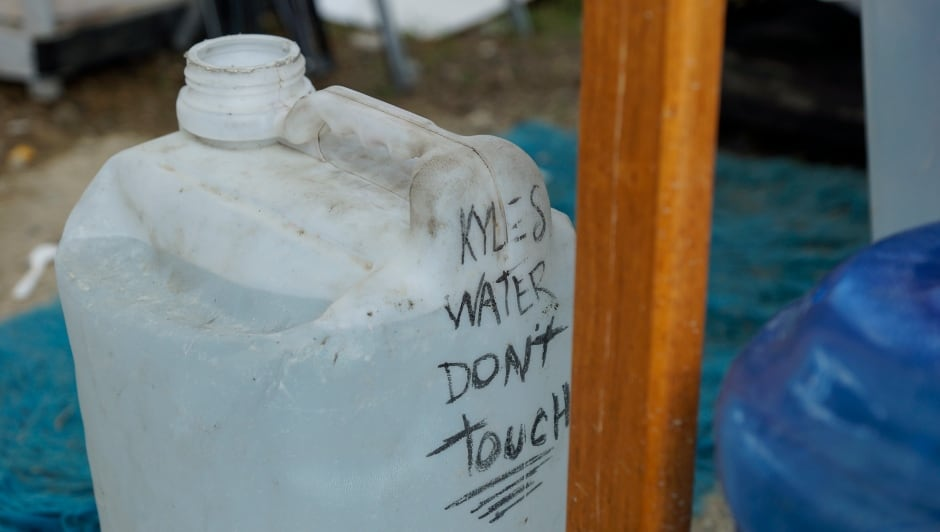 Sugar Mountain tent city water jugs