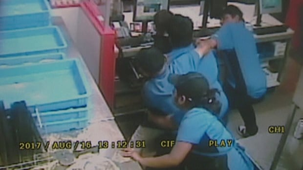 A group of employees at a Domino's Pizza on Kingston Road tackled a gunman and held him until police arrived.